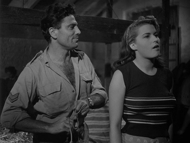 Raf Vallone as Marco, entranced by Silvana in Giuseppe De Santis' Bitter Rice (1949)