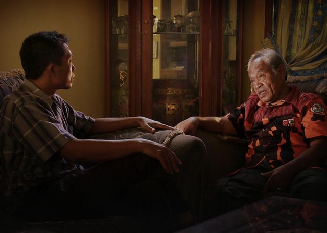 A chilling moment: one of the killers responds by asking for the name of Adi's village in Joshua Oppenheimer's The Look of Silence (2014)