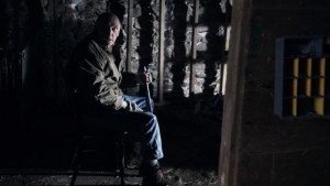 """Pop Pop is """"just cleaning my gun"""" in the barn in M. Night Shyamalan's The Visit (2015)"""