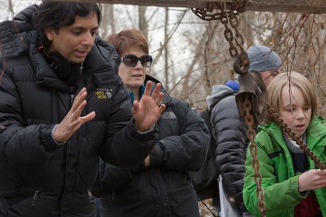 On location for The Visit (2015), M. Night Shyamalan directs Ed Oxenbould as Tyler