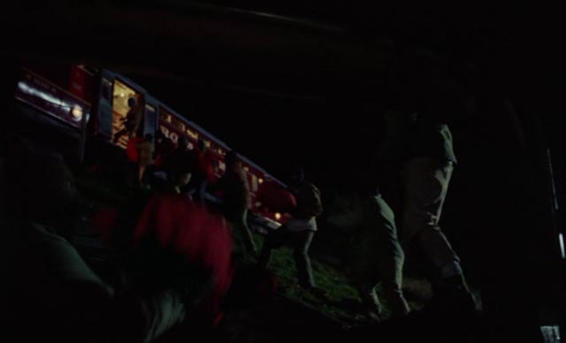 The gang unloading sacks of cash from the mail train in Peter Yates' Robbery (1967)
