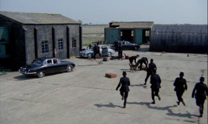 Police raid the gang's hideout in Peter Yates' Robbery (1967)