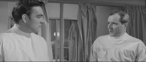 Richard Johnson and Michael Goodliffe as doctors working together despite personal conflicts in Val Guest's 80,000 Suspects (1963)
