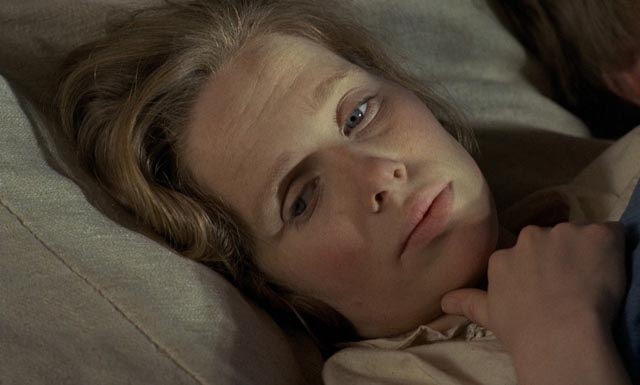 Kristina suffers from homesickness and the absence of community in Jan Troell's The New Land (1972)