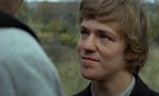 Eddie Axberg as Karl Oskar's younger brother Robert, dreaming of Californian gold fields in Jan Troell's The New Land (1972)