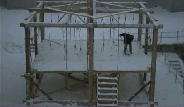The bleak winter site of a mass execution in Jan Troell's The New Land (1972)