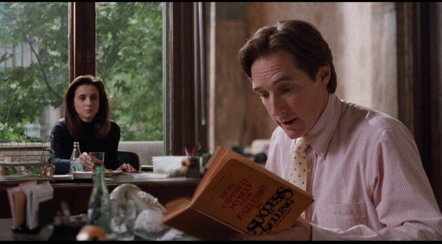 Ted (Taylor Nichols) diligently reads self-help books to improve his salesmanship in Whit Stillman's Barcelona (1994)