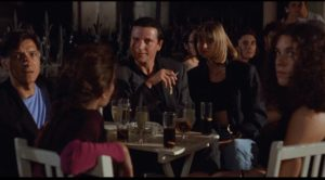 Left-wind journalist Ramon (Pep Munne) is disdainful of naive Americans in Whit Stillman's Barcelona (1994)
