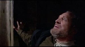 The sadistic magistrate Whitman, tormented by a demon in Gordon Hessler's Cry of the Banshee (1970)