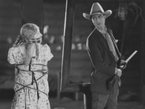 Mae and Julian in a classic silent film situation in Anthony Asquith's Shooting Stars (1928)