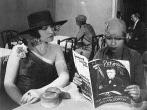 Mae (in background) forgotten, waiting to be called to set as an extra in Anthony Asquith's Shooting Stars (1928)
