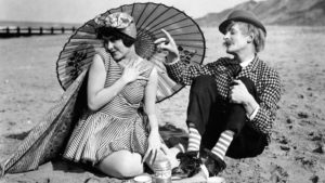Andy Wilkes (Donald Calthrop) pitching comic woo on the beach in Anthony Asquith's Shooting Stars (1928)