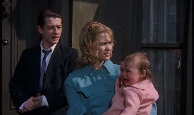 Timothy and Beryl Evans with their baby daughter, taking rooms at 10 Rillington Place in Richard Fleischer's 1971 true-crime movie