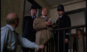 Serial killer John Reginald Christie helps the police in Richard Fleischer's true-crime movie 10 Rillington Place (1971)