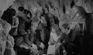 Jenny and her friends, including Adam Faith, party in a cave in Edmond T. Greville's Beat Girl (1959)
