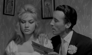 Sleazy club owner Kenny King (Christopher Lee) tempts the underage Jenny (Gillian Hills) in Edmond T. Greville's Beat Girl (1959)