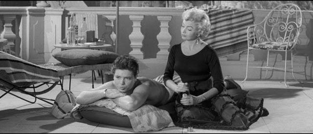 Cliff Richard as Bongo Herbert relaxes with Dixie Collins (Yolande Donlan) in Val Guest's satirical musical Expresso Bongo (1959)