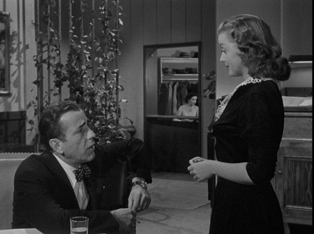 Dix Steele invites hatcheck girl Mildred home to tell him the plot of a novel in Nicholas Ray's In a Lonely Place (1950)