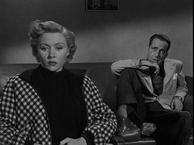 Laurel and Dix meet in Captain Lochner's office where she provides his alibi in Nicholas Ray's In a Lonely Place (1950)