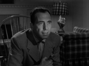 Dix relishes describing the murder to Brub and his wife in Nicholas Ray's In a Lonely Place (1950)