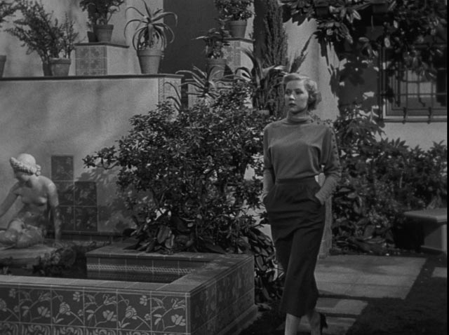 Gloria Grahame as Laurel Grey, the woman next door who attracts Dix Steele's interest in Nicholas Ray's In a Lonely Place (1950)