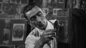 Gennaro Pisano as the small town photographer Celestino granted supernatural power in Roberto Rossellini's The Machine That Kills Bad People (1952)