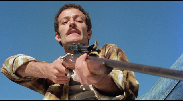 Sammy Williams as the sniper in the opening sequence of Larry Cohen's God Told Me To (1976)