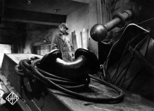 Werner Holk (Hans Albers) surveys the aftermath of sabotage in Karl Hartl's Gold (1934)