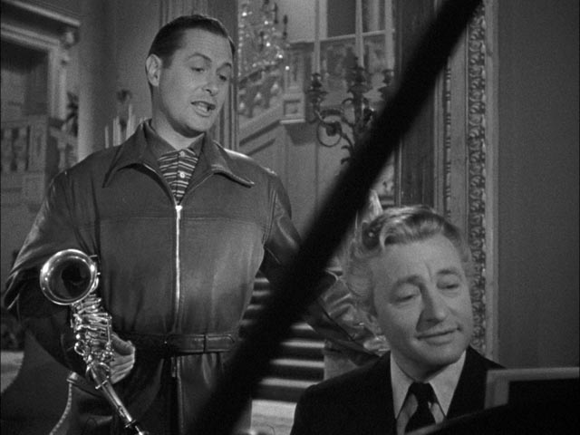 Mr. Jordan (Claude Rains) tries to convince Joe he should take the body of murdered businessman Bruce Farnsworth in Alexander Hall's Here Comes Mr. Jordan (1941)