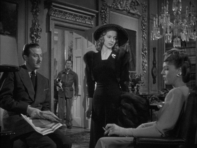 Bette Logan (Evelyn Keyes) gets the brush-off from Julia Farnsworth and Tony Abbott in Alexander Hall's Here Comes Mr. Jordan (1941)