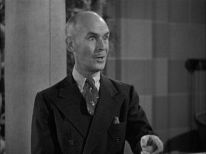 James Gleason as Joe's perplexed manager Max Corkle in Alexander Hall's Here Comes Mr. Jordan (1941)