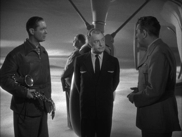 Boxer Joe Pendleton argues with the Heavenly bureaucracy about not being dead in Alexander Hall's Here Comes Mr. Jordan (1941)