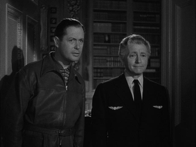 Joe Pendleton (Robert Montgomery) and Mr. Jordan (Claude Rains) in Alexander Hall's Here Comes Mr. Jordan (1941)