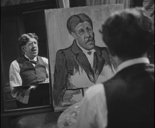 Maurice Legrand (Michel Simon) works on his self-portrait in Jean Renoir's La Chienne (1931)