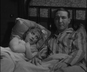 Lulu (Janie Marese) and her pimp Dede (Georges Flamant) in the room Maurice Legrand (Michel Simon) pays for in Jean Renoir's La Chienne (1931)