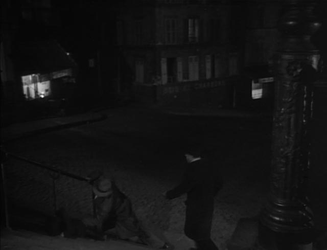 On his way home Maurice Legrand (Michel Simon) sees the pimp Dede Georges Flamand) striking Lulu (Janie Marese) in Jean Renoir's La Chienne (1931)