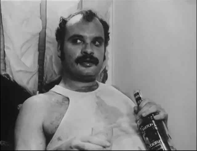 George Kuchar as Martin, caretaker of the Welcome Apartments in Rufus Butler Seder's Screamplay (1985)