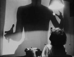 Screenwriter Edgar Allen (Rufus B. Seder), overshadowed by his own imagination in Rufus Butler Seder's Screamplay (1985)