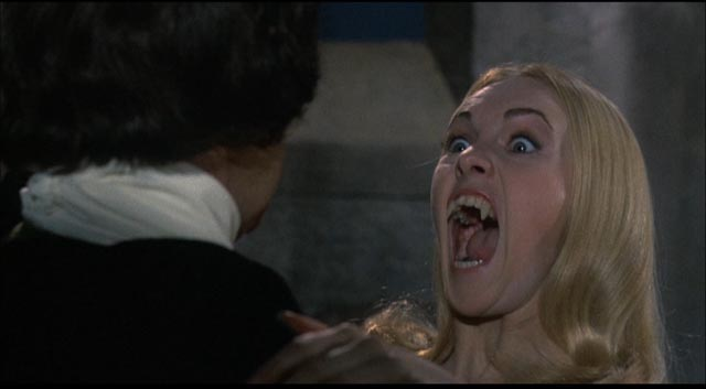 One of the Karnstein brood about to put the bite on Baron von Hartog in Roy Ward Baker's The Vampire Lovers (1970)