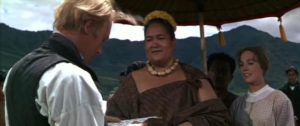 Malama (Jocelyne LaGarde) proudly shows Reverend Hale (Max von Sydow) the letter she has written to the President in George Roy Hill's Hawaii (1966)