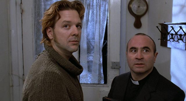 Mickey Rourke as the IRA killer Fallon and Bob Hoskins as the priest in Mike Hodges' A Prayer for the Dying (1987)