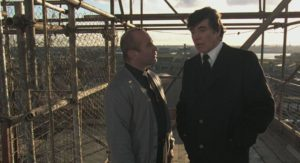 Gangster Jack Meehan (Alan Bates) threatens Father Michael (Bob Hoskins) in Mike Hodges' A Prayer for the Dying (1987)