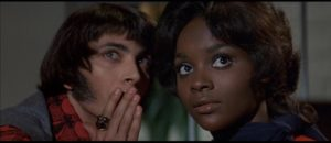 Z-Man Barzell with Carrie Nations drummer Petronella Danforth (Marcia McBroom) in Russ Meyer's Beyond the Valley of the Dolls (1970)