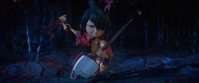 Kubo (Art Parkinson) uses his mother's shamisen in his fight with the Moon King in Travis Knight's Kubo and the Two Strings (2016)