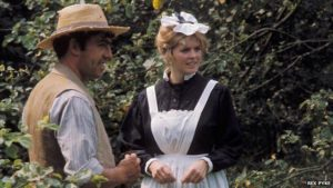 Tom Rouse, the grandfather, courting Charlotte (Lyn Brooks), a maid at the local manor in Peter Hall's film of Ronald Blythe's book Akenfield (1974)