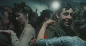 Tom Rouse, the father, meets Dulcie (Mary Hammond) at a village dance during World War Two in Peter Hall's film of Ronald Blythe's Akenfield (1974)
