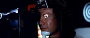 Roddy (Harvey Keitel) has a camera implanted in his eye in Bertrand Tavernier's Death Watch (1980)