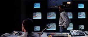 Vincent (Harry Dead Stanton) manipulates TV-mediated reality in Bertrand Tavernier's Death Watch (1980)