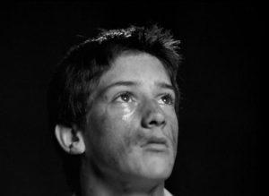 Hughie Restorick as the older brother Tommy in Bill Douglas' My Ain Folk (1973)