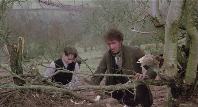 Amos and one of his sons mending a fence damaged by their hostile neighbour in Andrew Grieve's film of Bruce Chatwin's On the Black Hill (1988)